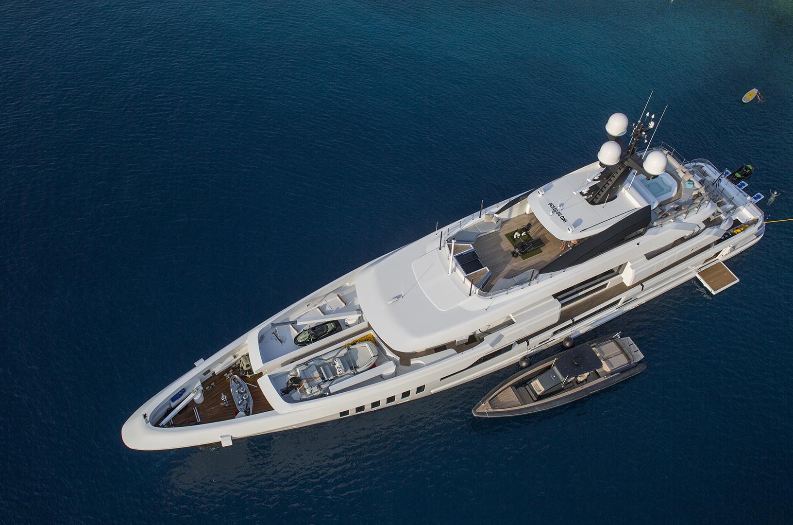 Yacht OURANOS - at anchor with all the water toys and tenders out