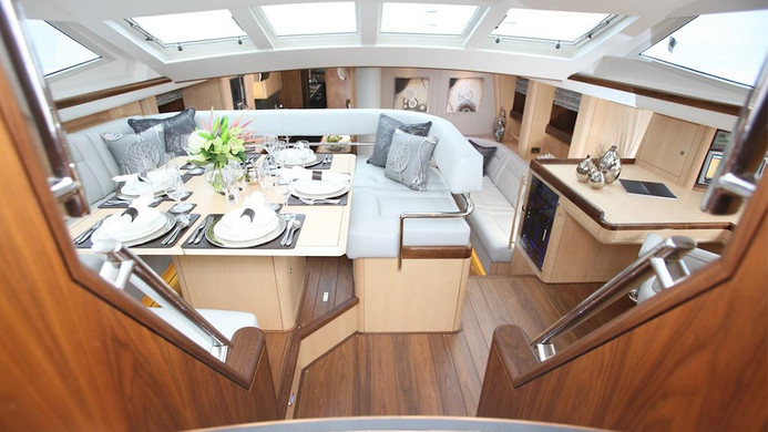 Sailing Yacht RAVEN - deck salon dinning, the typical Oyster 82 design, ideal for charter