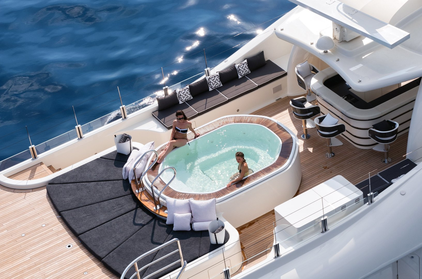 Ladies take a dip in the yacht's plunge pool