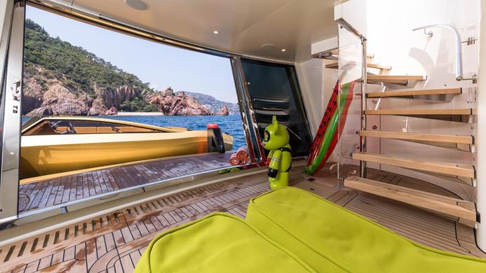 Yacht KHALILAH - beach club, tender docking to take charter guests ashore