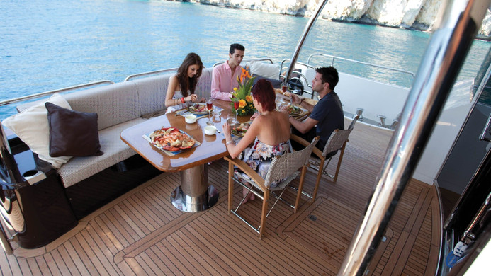 Yacht TUPPENCE - charter guests enjoying Al fresco lunch on the aft deck