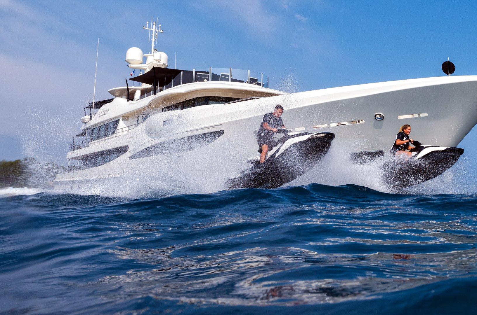 Jet skiing round the yacht