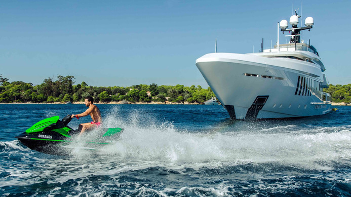 Yacht OURANOS - charter guest at full chat on the waverunner jetski