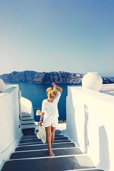 Woman in Santorini, exploring ashore during yacht charter