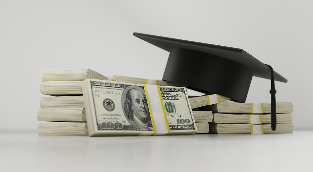 Mortarboard Stack of Money Rising cost of college