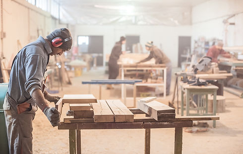 Man doing woodwork in carpentry. Carpenter work on wood plank in workshop.jpg