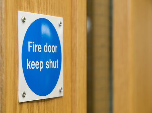Fire Door Keep Shut Sign on a Wooden Fire Door.jpg