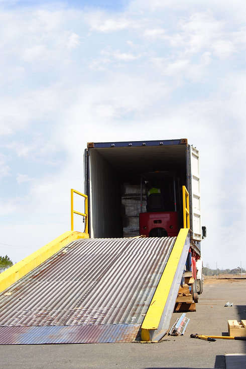 Semi truck with forklift driver in back