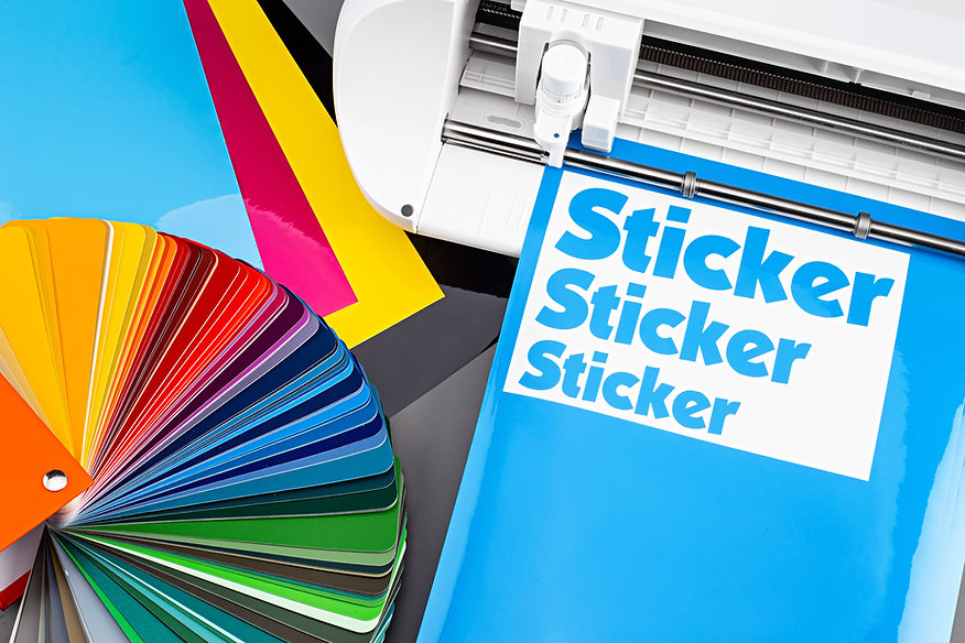 production making sticker with plotter cutting machine on CMYK cyan blue colored vinyl fim