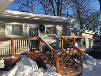 Built in West Bloomfield, Michigan. Treated decking with cedar railing and black round decorator spindles.