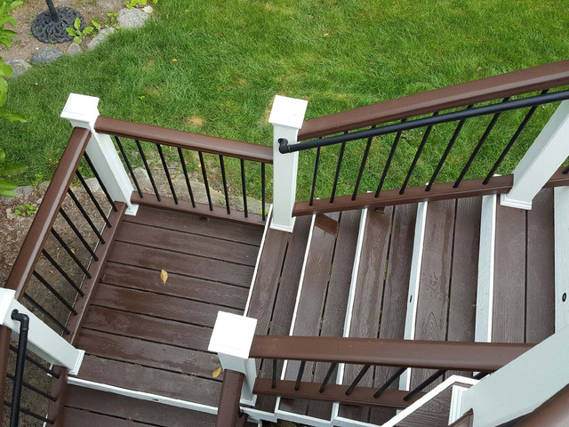Built in Lake Orion, Michigan.  Trex products used:  transcends vintage lantern decking transcends white posts with lights transcends vintage lantern railing transcends white fascia.