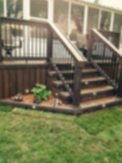 This is a deck and staircase built by Creative Decks and Finished Carpentry, LLC.