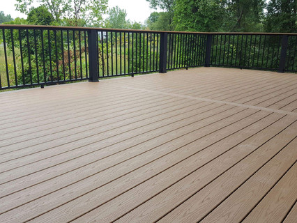 Built in Lake Orion, Michigan.  Trex products used:  enhance beach dune decking black signature railing enhance beach dune cocktail top enhance beach dune fascia