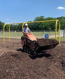 installing playground surface.jpg