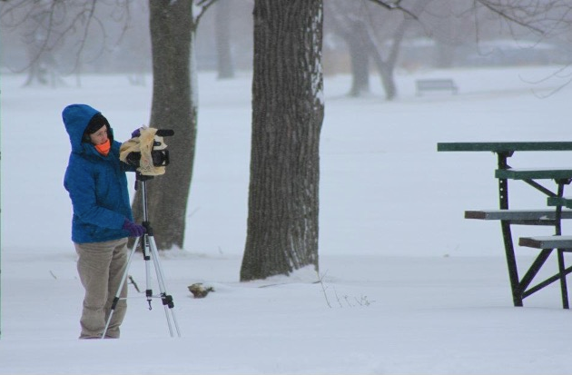The Fan Connection director, Mary Wall, sets up a shot in the middle of a Buffalo snow storm.