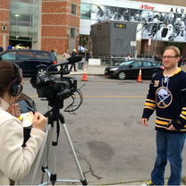 The Fan Connection director, Mary Wall, interviews Mark before a Sabres game.