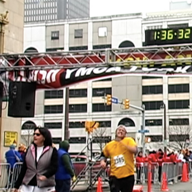 Mark crosses the finish line of the YMCA Buffalo Turkey Trot