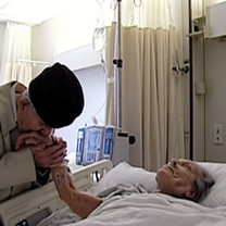 Mickey visits his wife, Frances, before she undergoes surgery.