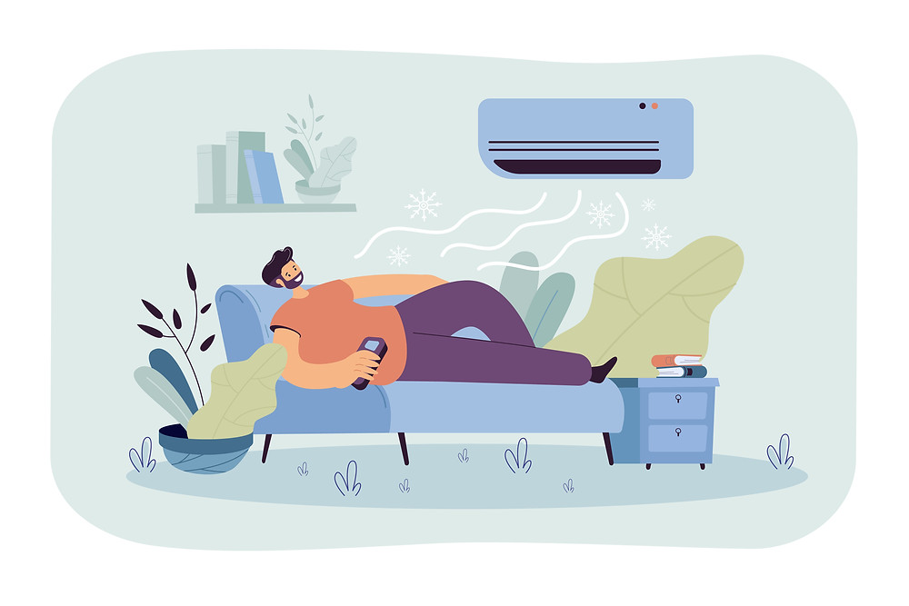 happy man lying down on couch cool air from AC unit
