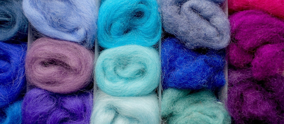 A colorful collection of wool bundles.
