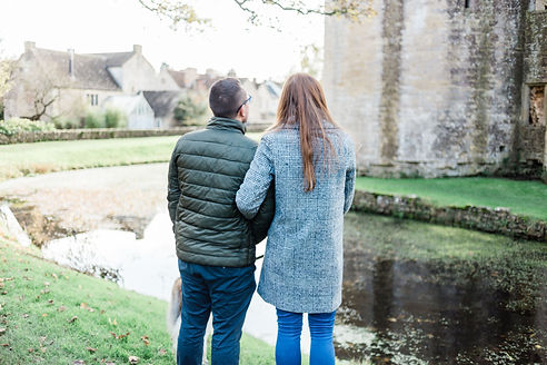 Engaged couple having natural photos taken at Nunney Castle, Frome, Somerset