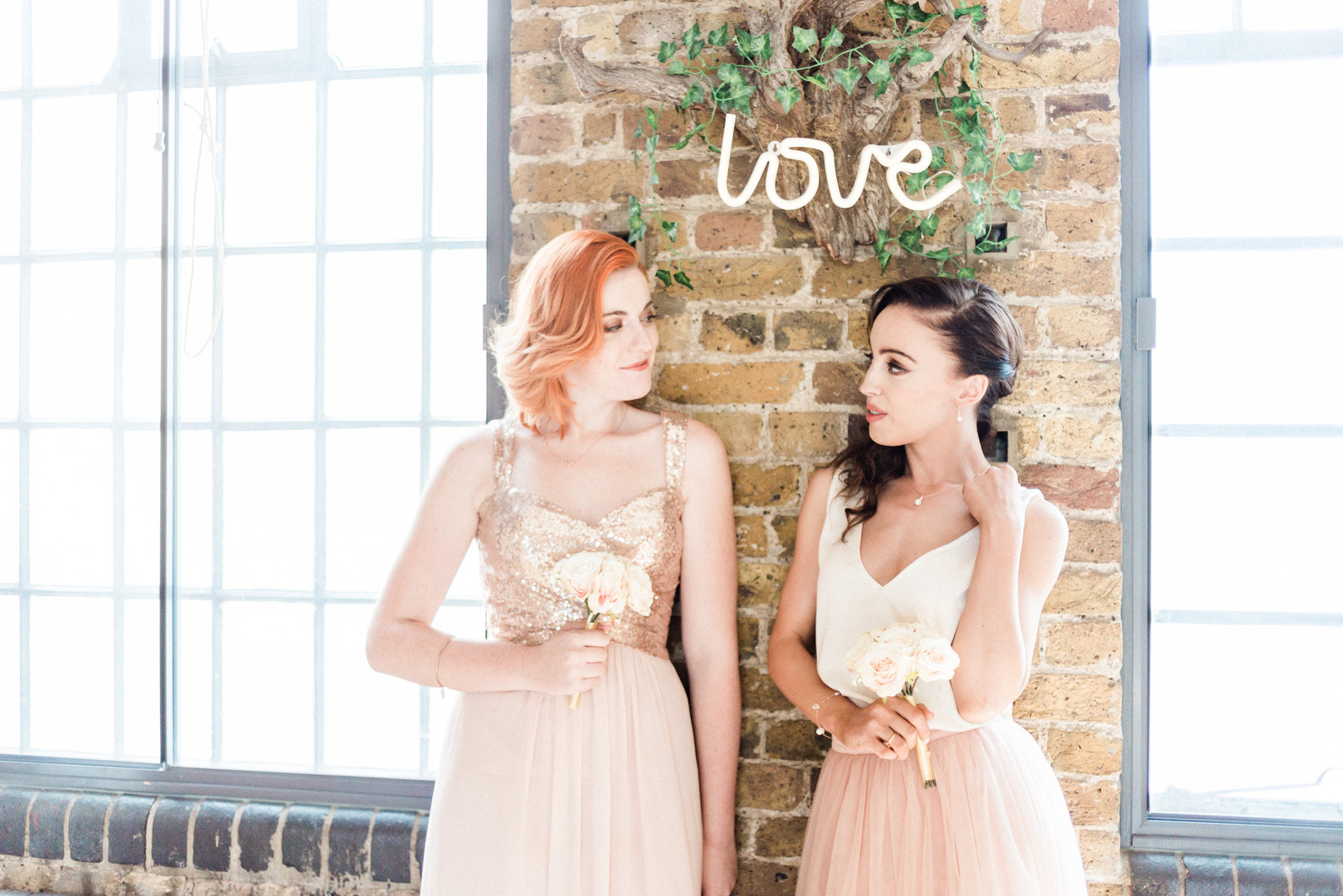 Bridesmaids in rose gold dresses at Hackney industrial style venue