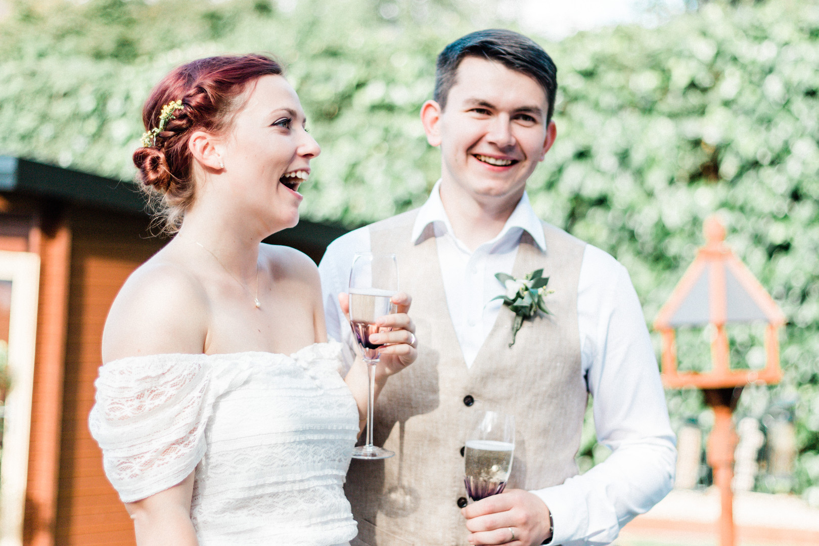 Hampshire documentary wedding photo of laughing bride and groom
