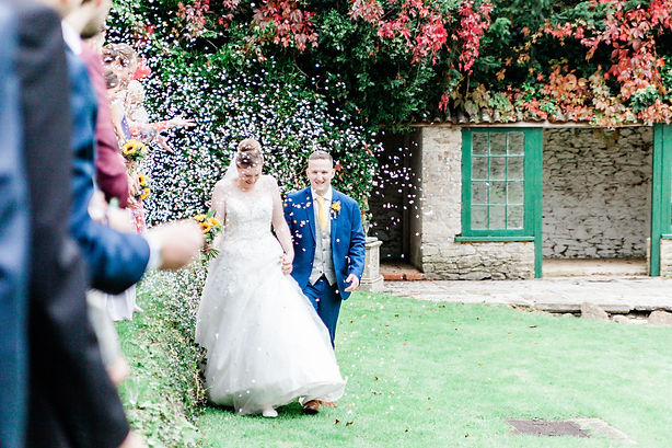 Holbrook Manor wedding photography capturing bride and groom with confetti