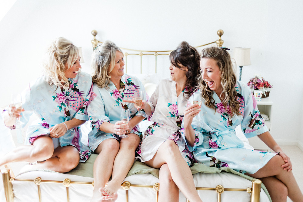 Bride and bridesmaids in matching robes during wedding preparations at Berkshire wedding