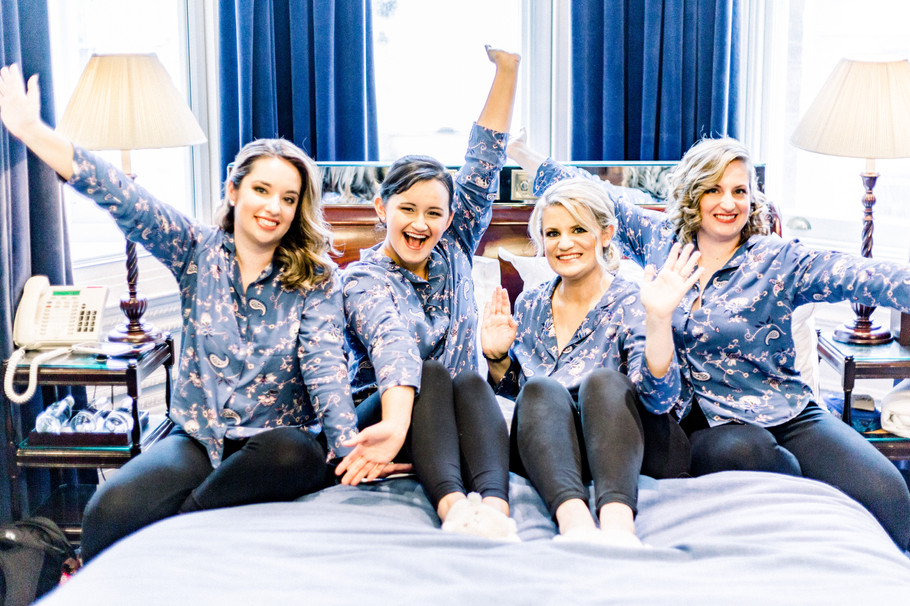 Bride and bridesmaids having fun before Chesterfield Hotel wedding
