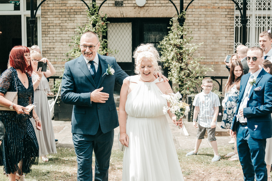 Bride and groom confetti exit at wedding in Feltham