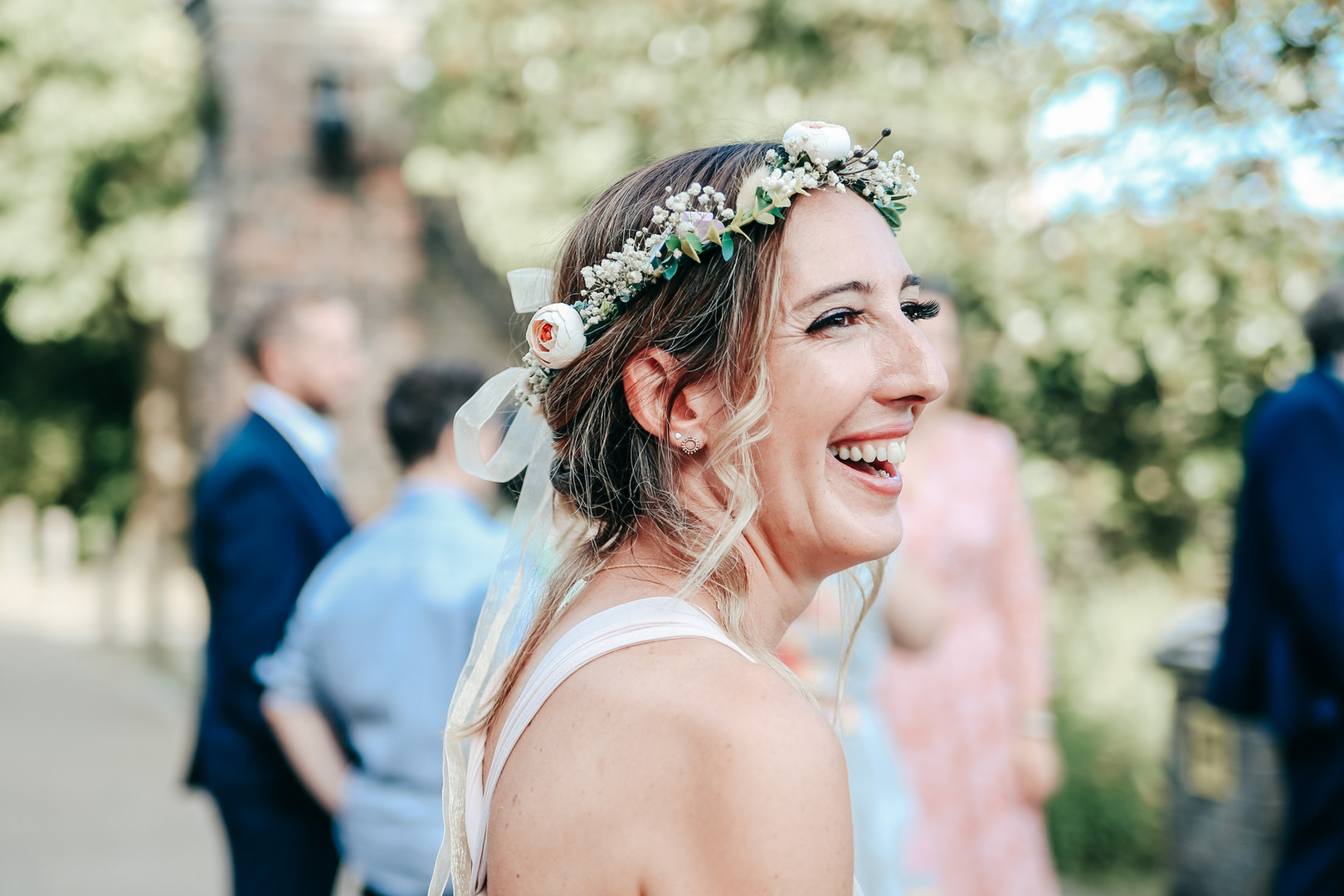 Candid wedding photography of laughing bride at York House Twickenham