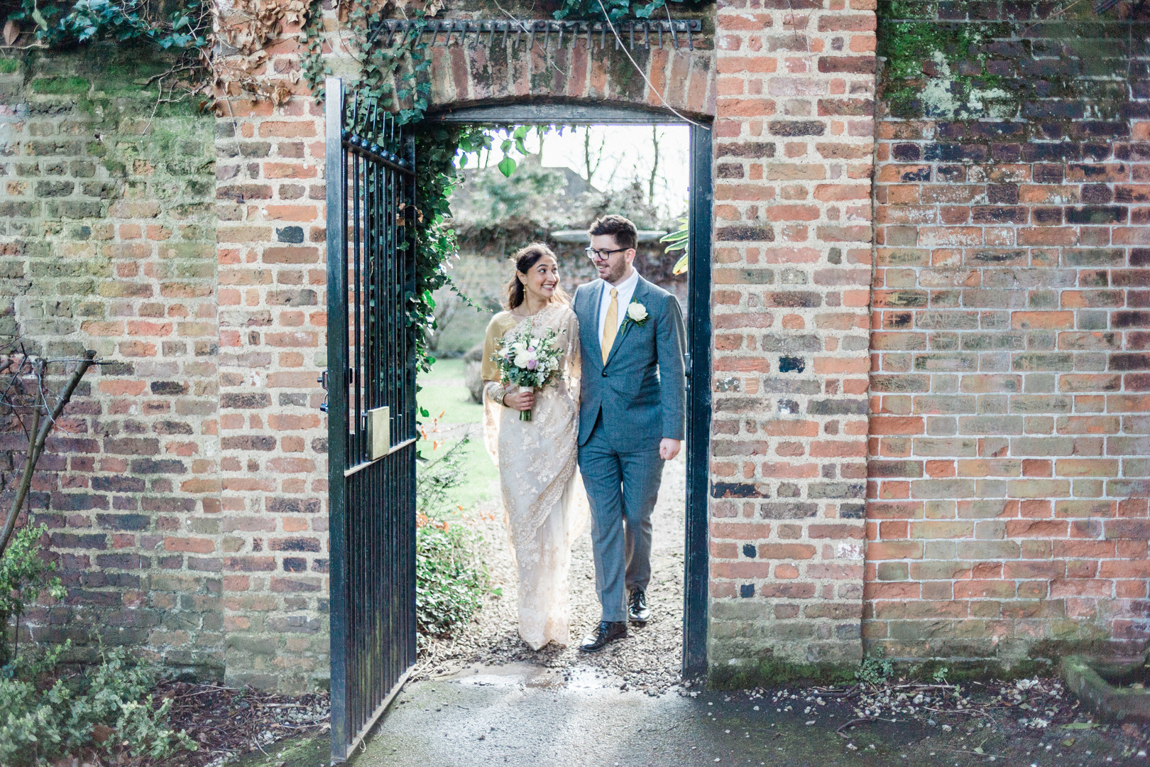 Natural wedding photo of bride and groom at Charlton House wedding