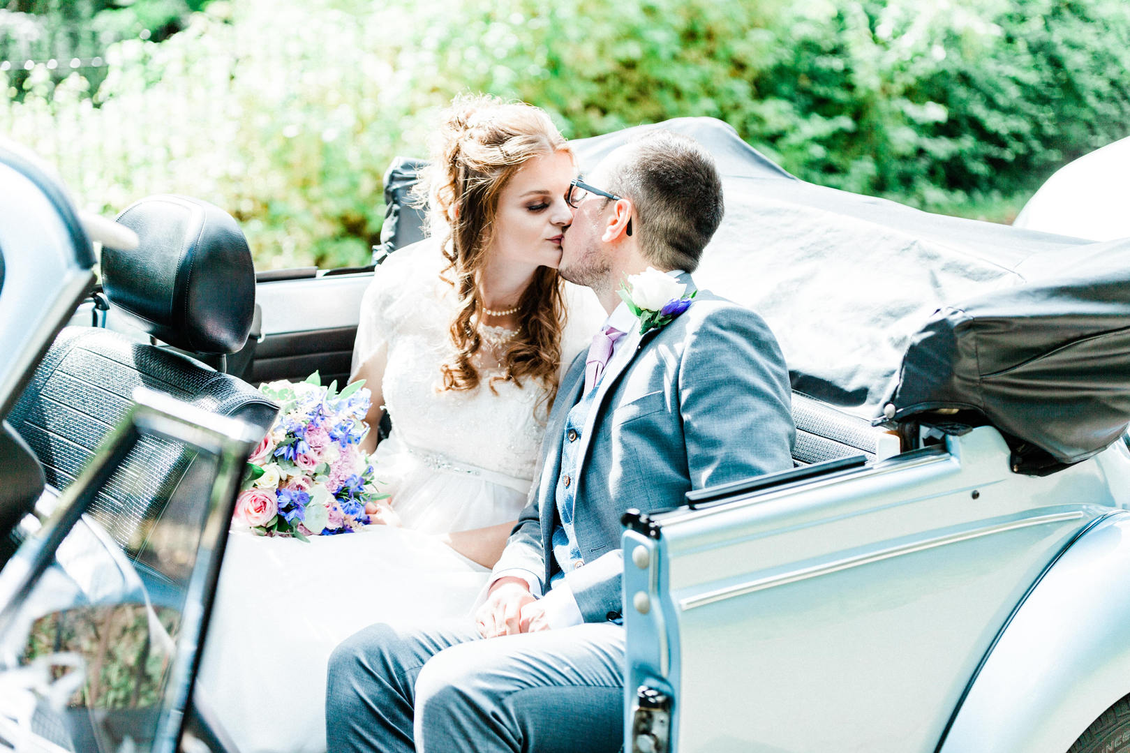 Wedding photography at Royal Victoria Park in Bath, bride and groom portrait in VW Beetle