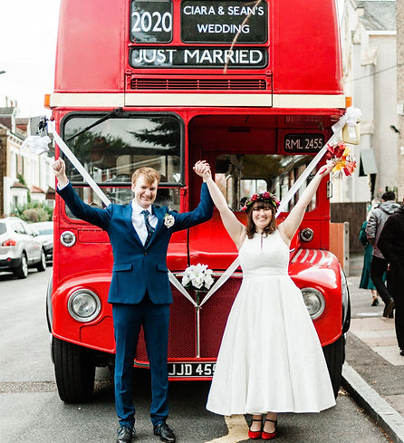 London wedding photographer shooting bride and groom fun photo with London wedding bus