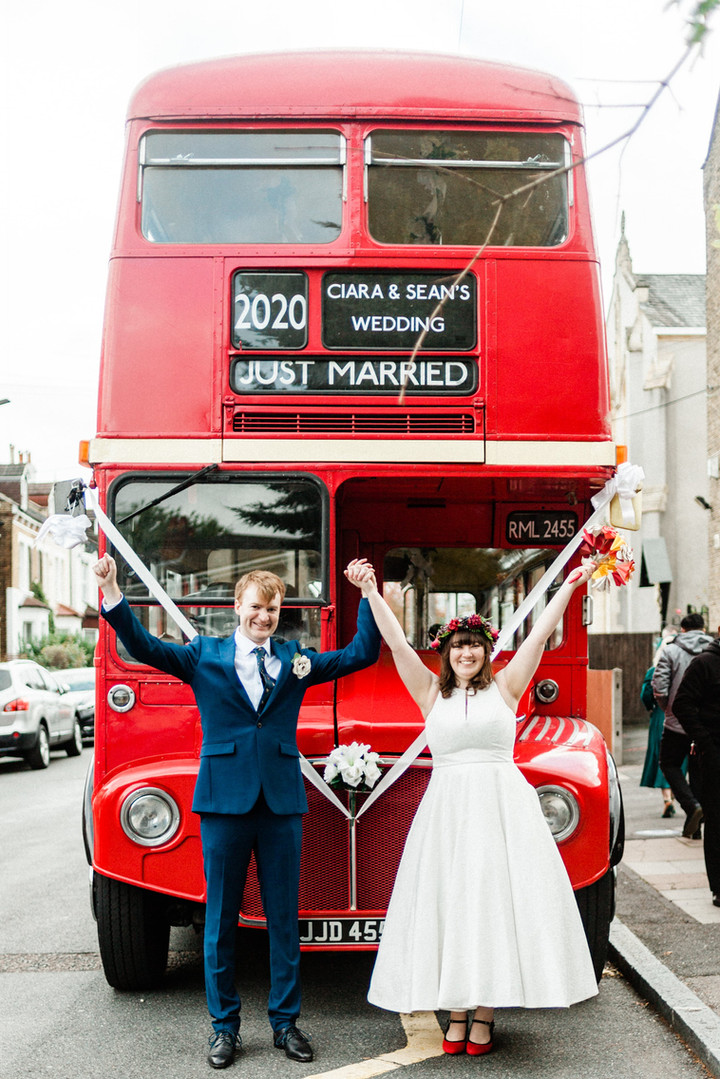 Fun London wedding photography with Routemaster bus