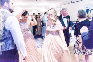 Rose gold bridesmaids dancing at Chesterfield Hotel wedding