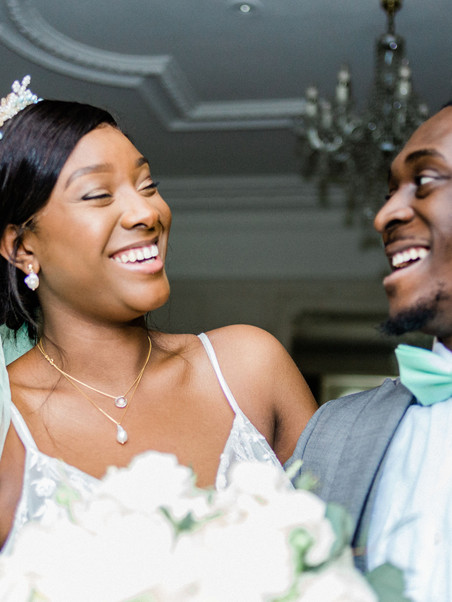 Natural wedding photo of bride and groom at Warren House, Kingston