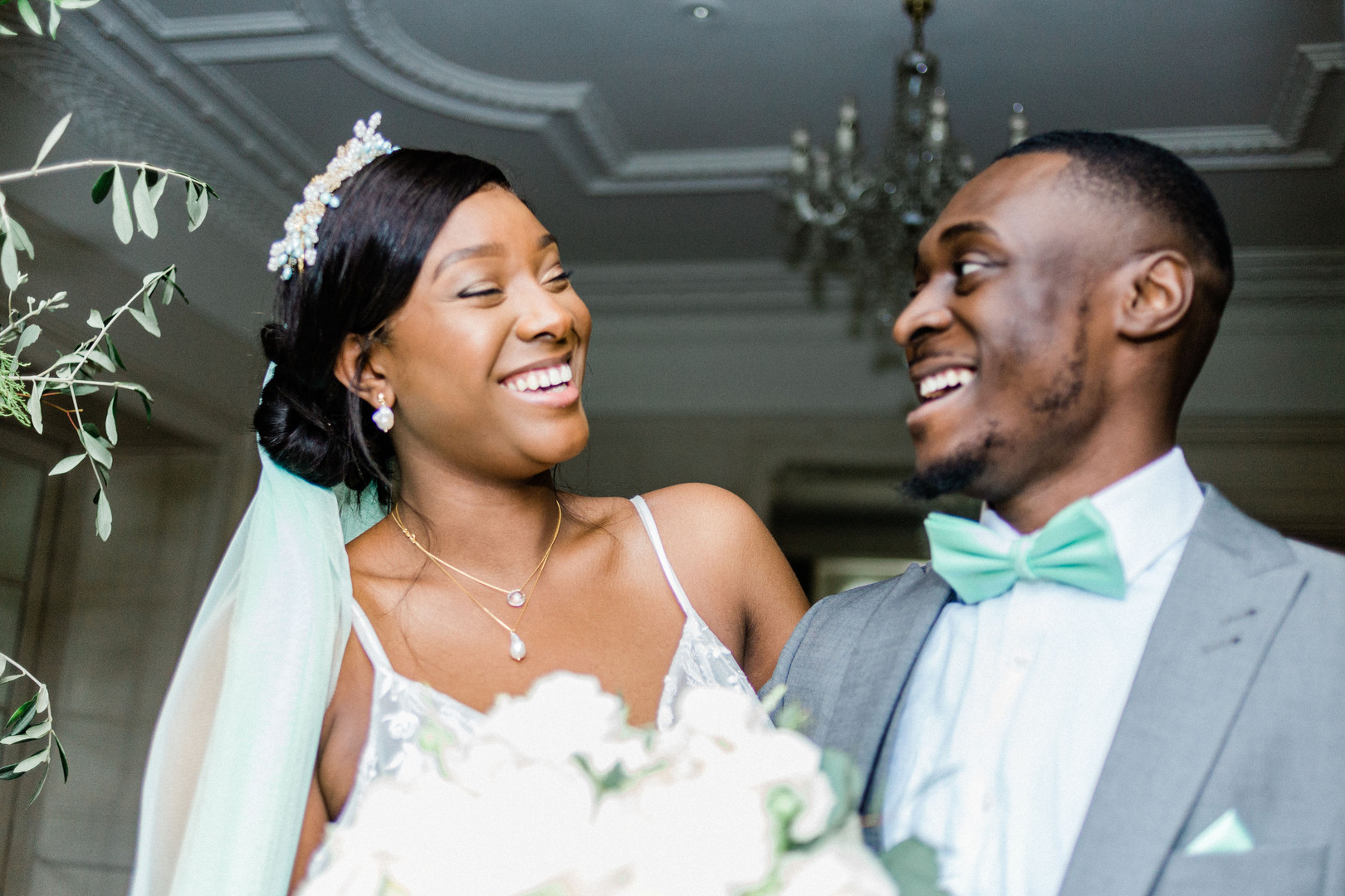Bride and groom laughing in natural Warren House wedding photo