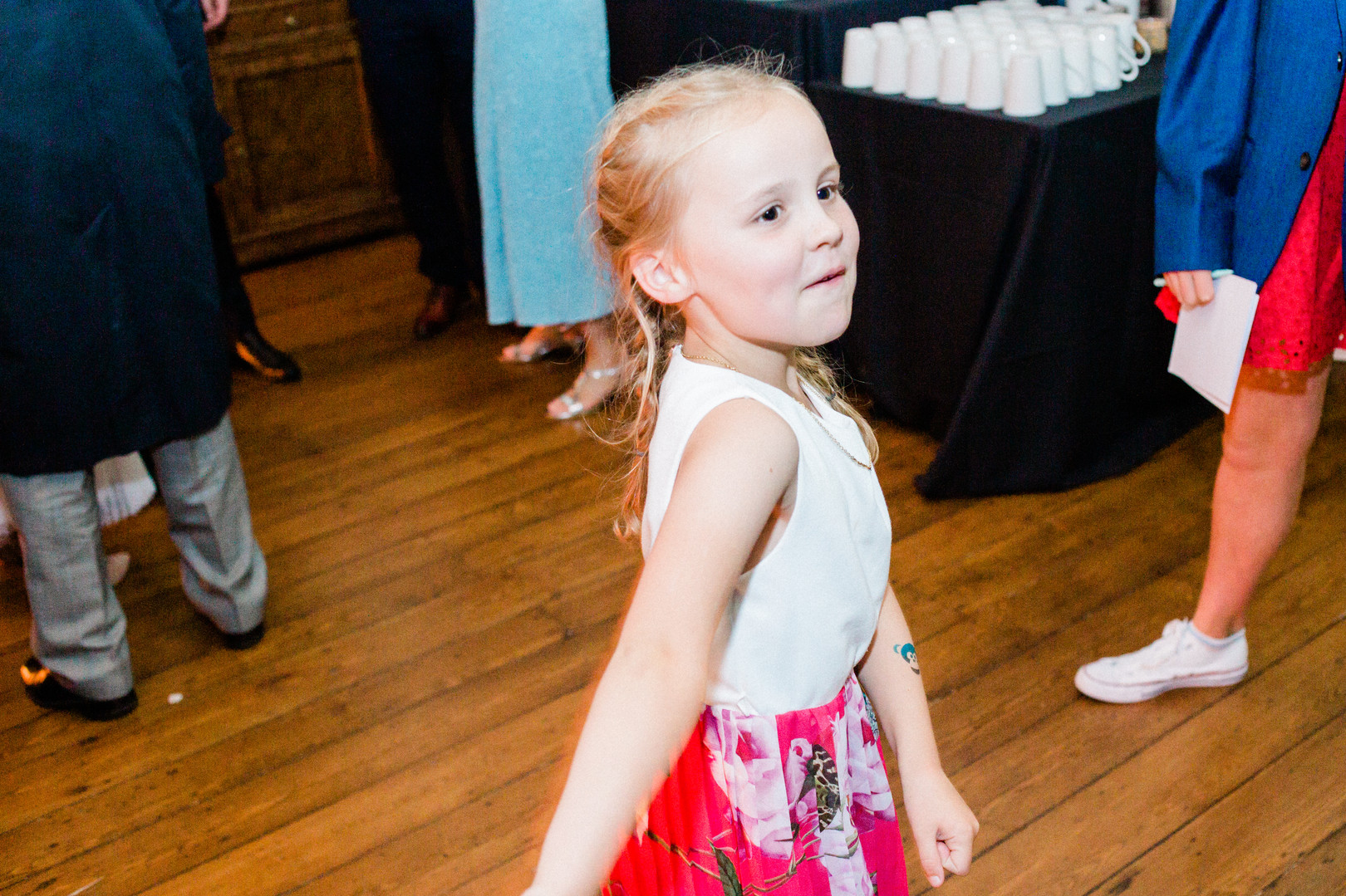 Natural shot of little girl dancing at Clissold House wedding reception