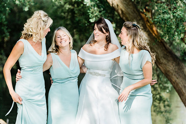 Natural shot of bride and bridesmaids at outdoor wedding reception in Berkshire