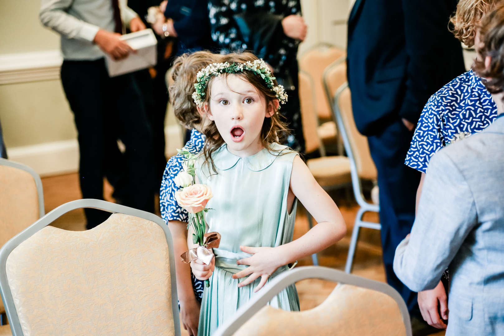 Flower girl in green silk dress and flower crown, shot by natural wedding photographer at York House