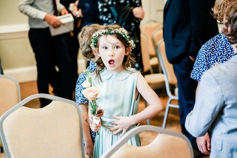 Natural funny shot of flower girl at York House wedding