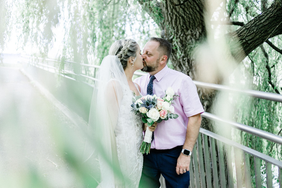 Romantic wedding photo of bride and groom at Taunton Castle in Somerset