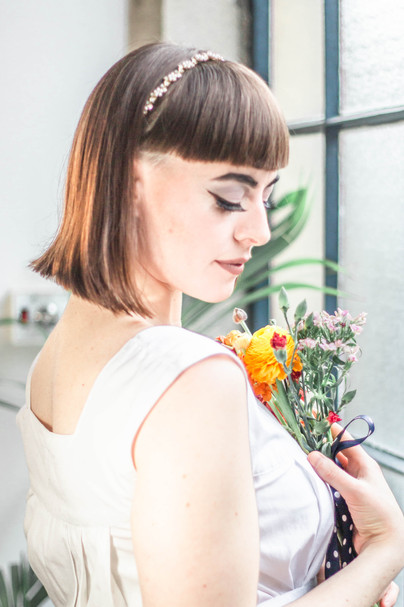 Hackney boho bride getting ready for her wedding at loft style apartment