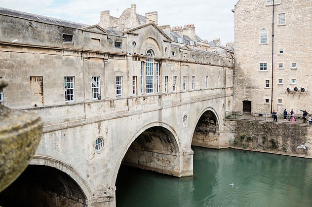 Pulteney Bridge in Bath, Somerset, shot by a Bath wedding photographer. The perfect place for wedding photos.