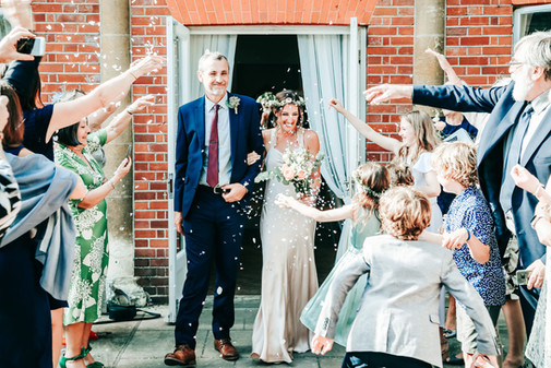 Bride and groom at York House, Twickenham confetti exit