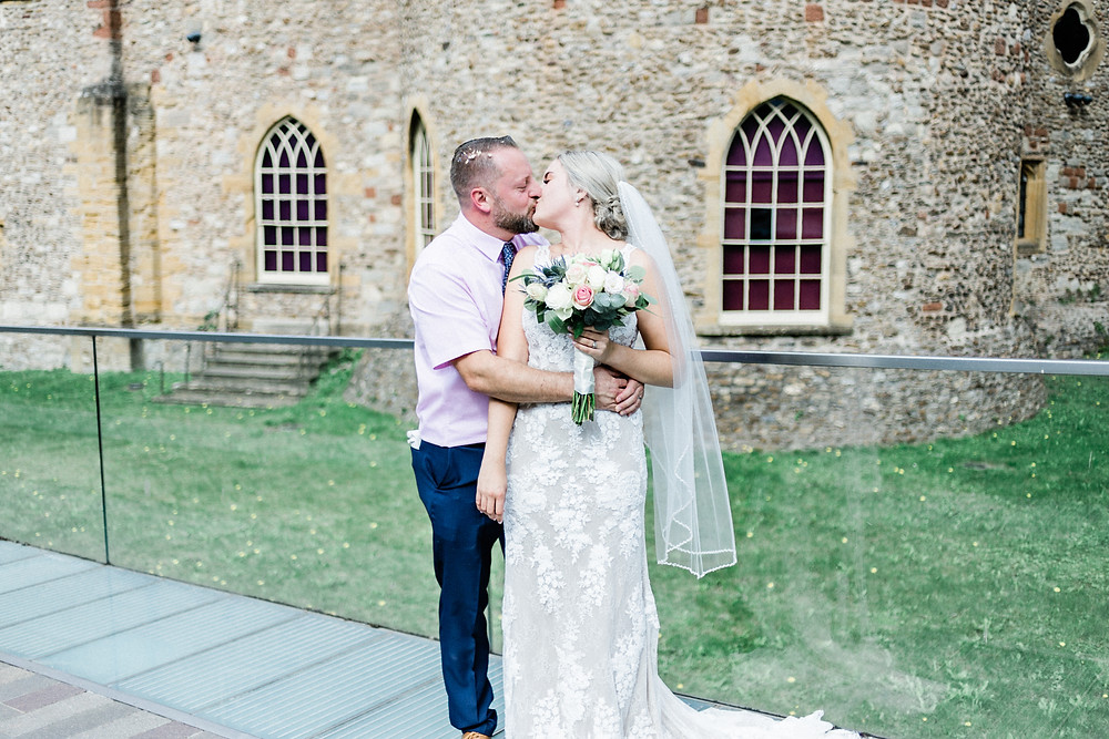 Romantic wedding photo of bride and groom at Taunton Castle by Somerset wedding photographer