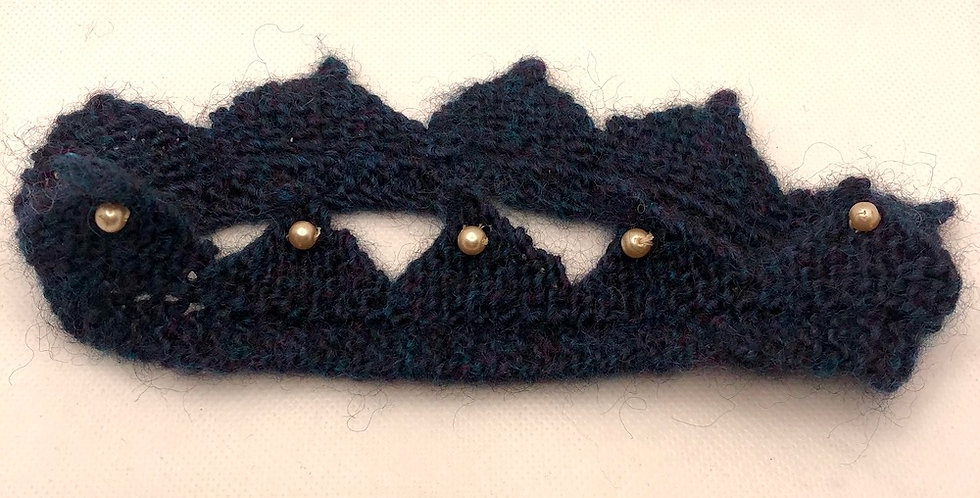 Hand knitted crown with pearls