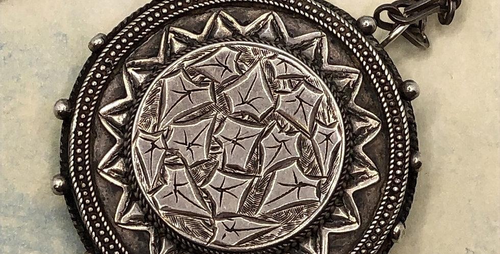 Victorian silver locket-back pendant on chain
